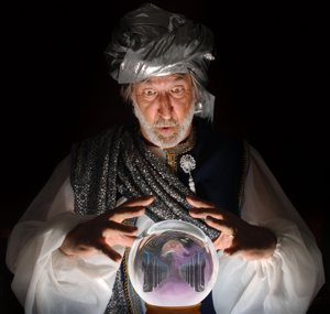 fortune teller looks into crystal ball to see the future of Web hosting
